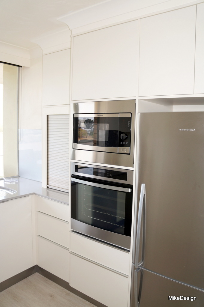Kitchen Oven Tower With Appliance Cabinet In Stainless