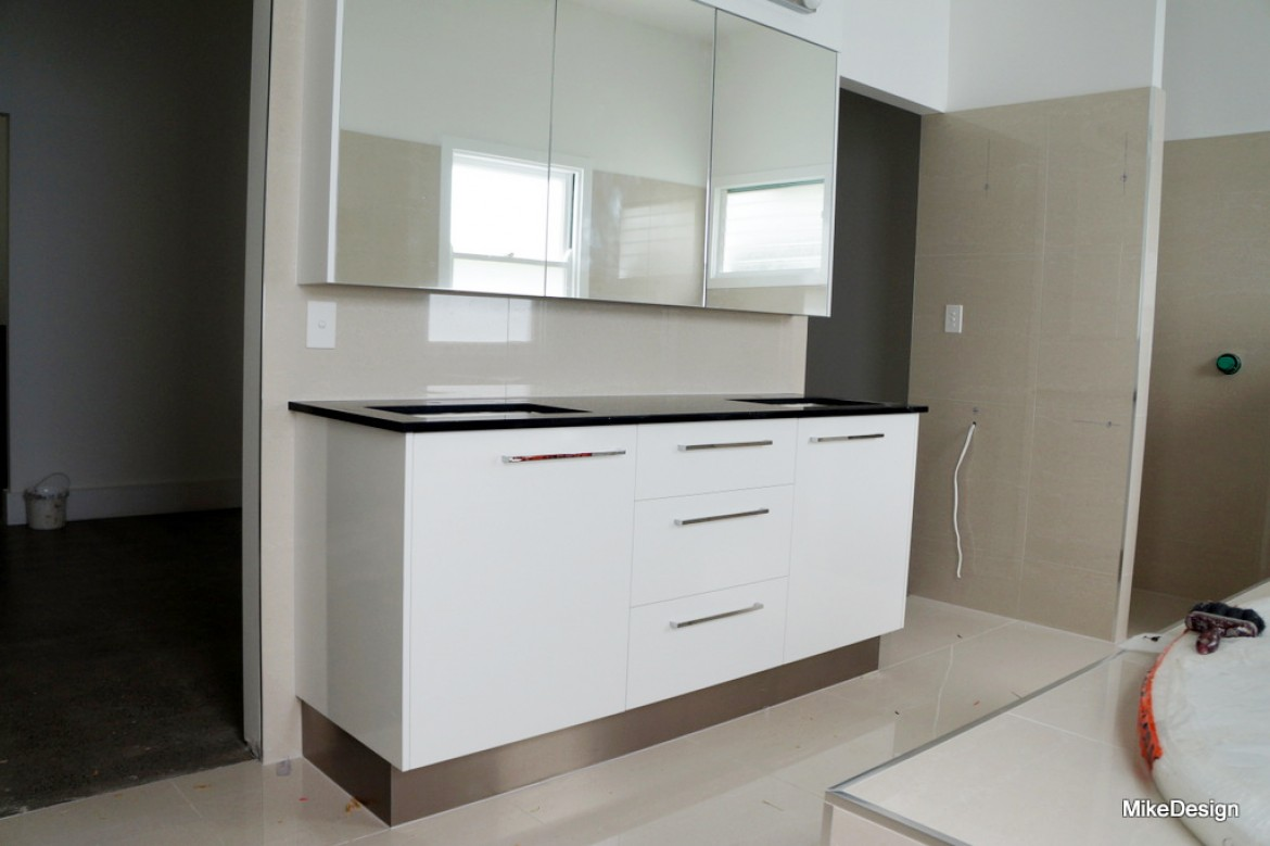 Bathroom vanity with white gloss melamine board and black starlight