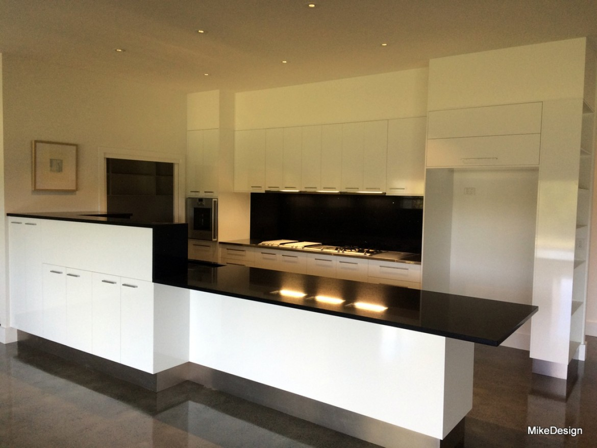 Kitchen In White Gloss Melamine Board With 40mm Starlight Black Stone Bench Tops And Waterfall