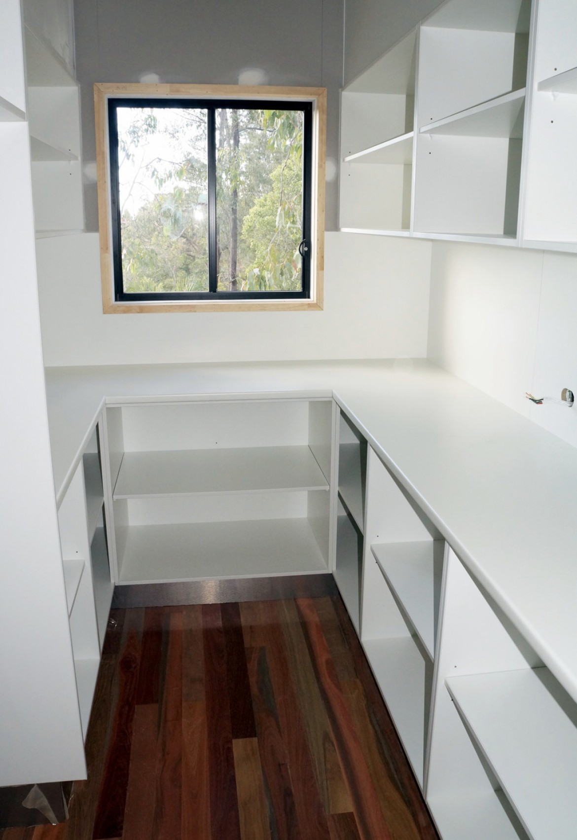 Walk In Pantry With Laminated Benchtops And White Overhead